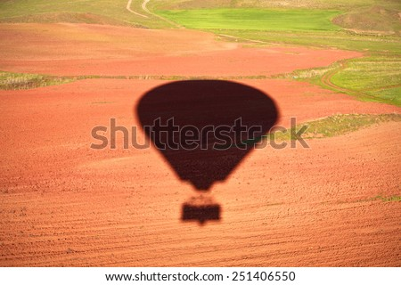 Silhouette of hot air balloon floating - stock photo