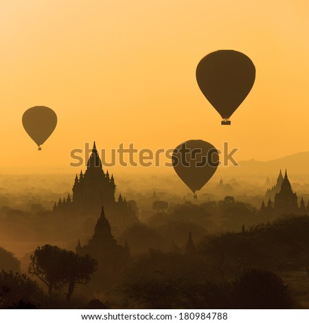 Silhouette of Hot Air Balloons over the temples of Bagan - Myanmar - stock photo