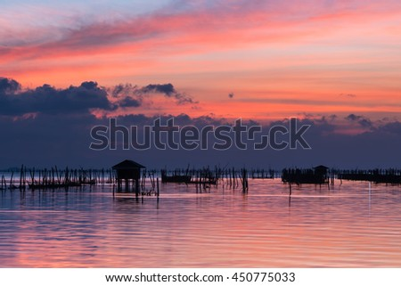 silhouette of hut over the water at sunset, Koh Yor, Songkhla, Thailand