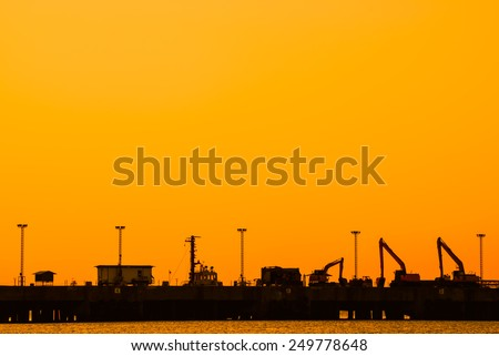 silhouette of Industrial shipping port in thailand - stock photo