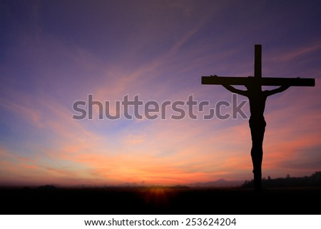 Silhouette of Jesus with Cross over sunset concept for religion, worship, Christmas, Easter, Redeemer, prayer and praise. - stock photo