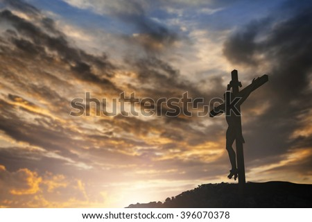 Silhouette of Jesus with Cross over sunset concept for religion, worship, Christmas, Easter, Redeemer Thanksgiving prayer and praise Orlando shooting ISIS  - stock photo