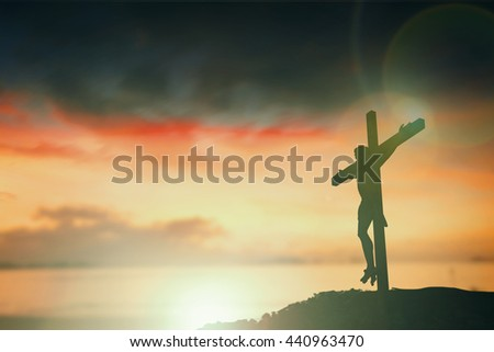 Silhouette of Jesus with Cross over sunset concept for religion, worship, Christmas, Easter, Redeemer Thanksgiving prayer and praise. revelation son happy world 2017 help care - stock photo