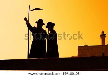 Silhouette of jewish people at sunset in Jerusalem - stock photo