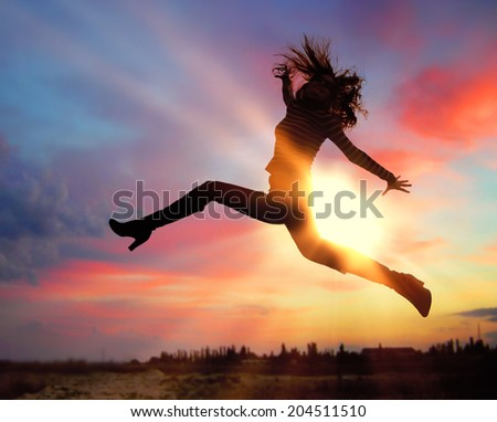 Silhouette of jumping girl - stock photo