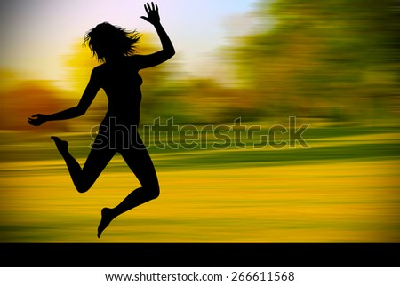 Silhouette of jumping teenagers with nature background - stock photo