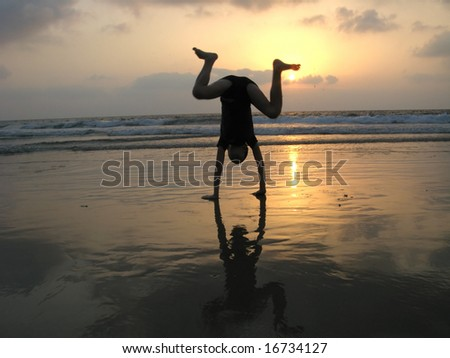 silhouette of kid on the beach at sunset