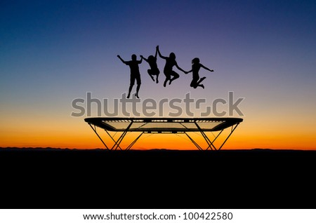 silhouette of kids on trampoline - stock photo