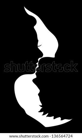 silhouette of kissing couple - stock photo