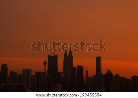 silhouette of KLCC and other skyscraper tower during golden sunrise