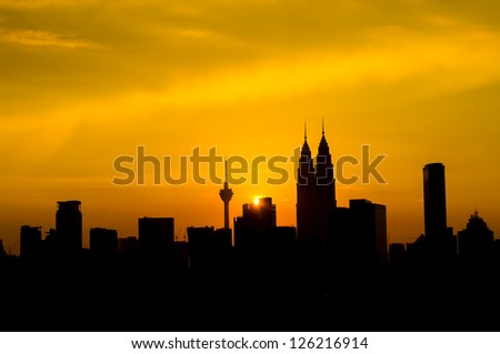 Silhouette of Kuala Lumpur twin towers during sunset at Malaysia, Asia