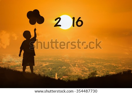 Silhouette of little boy  jump touch sunset new year 2016 - stock photo