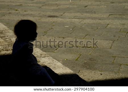 silhouette of little girl - stock photo