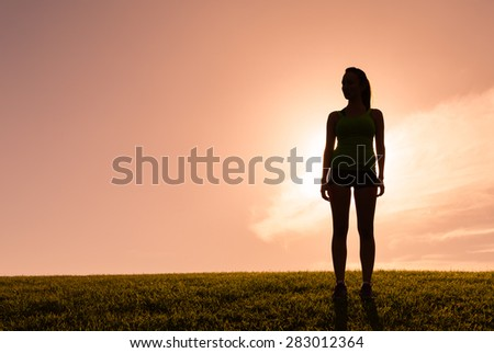 Silhouette of lone woman. - stock photo