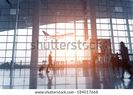 Silhouette of  luggage walking at airport - stock photo