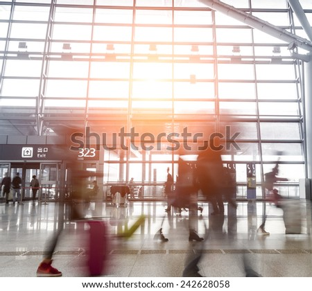 Silhouette of luggage walking at airport