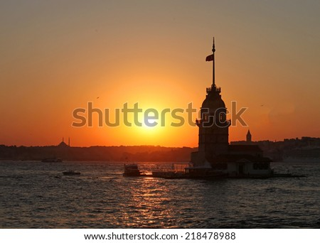 Silhouette of Maiden's Tower and Galata Tower - stock photo