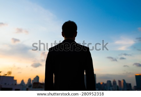 Silhouette of male in the city.  - stock photo