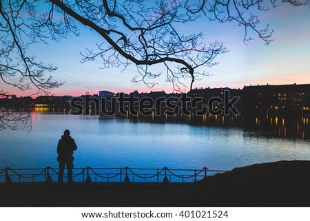 silhouette of man at dusk on the bridge in the city