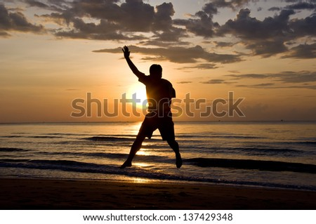 silhouette of man feel free and happy on the beach