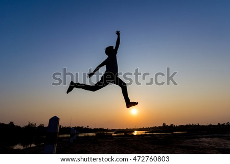silhouette of man jump on sunset