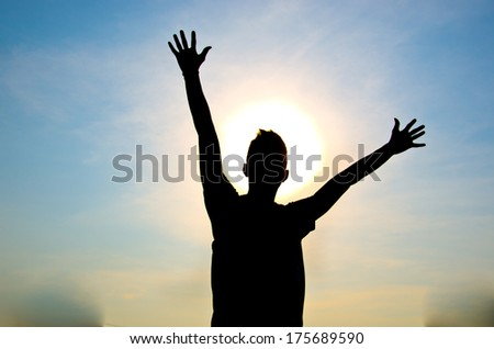 silhouette of man jumping for happy and victory