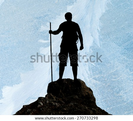 Silhouette of man on peak of mountain on ice background - stock photo