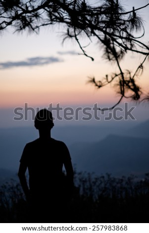 Silhouette of man on the mountain with sunrise. Element of design. - stock photo