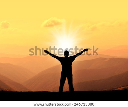 silhouette of man on the sunset in mountain