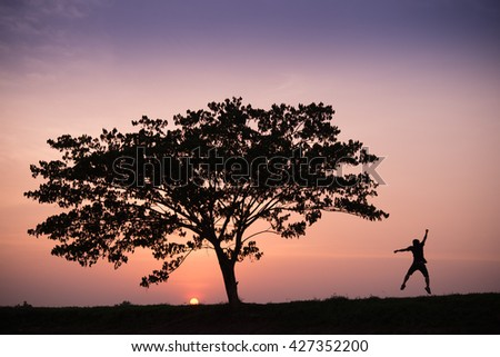 silhouette of man overjoy jump at sunrise