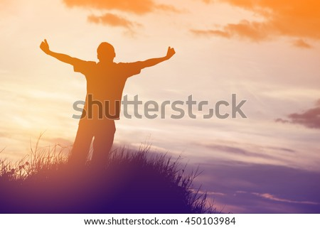 silhouette of man pointing with finger in sky