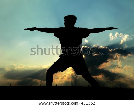 Silhouette of Man practicing Yoga - stock photo