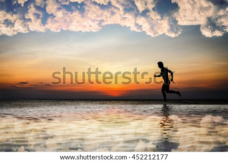 silhouette of man running on the beach