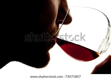 Silhouette of man tasting alcohol. Isolated on white - stock photo