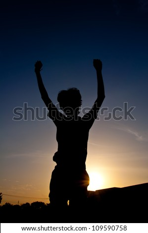 silhouette of man victory with medal prize - stock photo