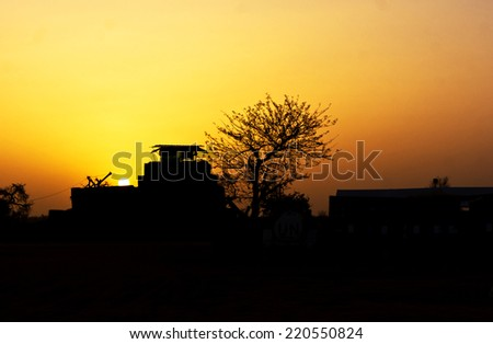 Silhouette of military forces with rifle against a sunset - stock photo