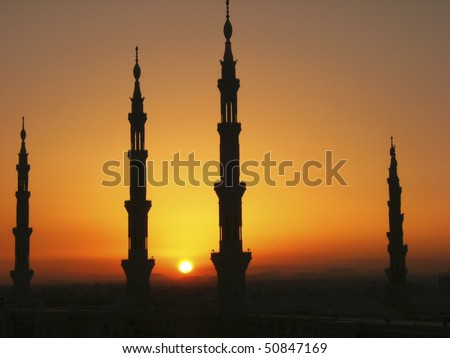 Silhouette of minarets of Masjid Al Nabawi or Nabawi Mosque (Mosque of the Prophet) in Medina (City of Lights), Saudi Arabia. Nabawi mosque is Islam's second holiest mosque after Haram Mosque. - stock photo