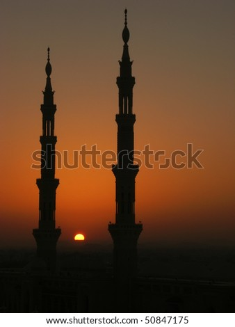 Silhouette of minarets of Nabawi mosque, Medina, Saudi Arabia - stock photo