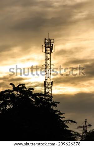 Silhouette of Mobile Telephone  Antenna. - stock photo