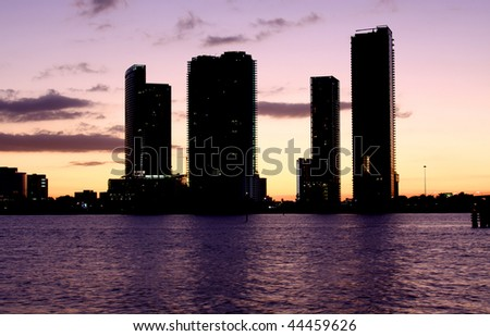 Silhouette of Modern Architecture in Famous travel destination in Miami Beach Florida. Skyscrapers in Downtown at sunset.