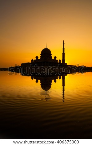 Silhouette of Mosque with reflection from the lake during sunrise at Putrajaya, Malaysia. - stock photo
