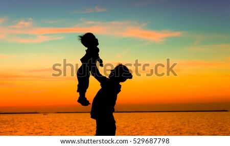 Silhouette of mother and child (color tone)
