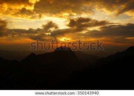 Silhouette of Mountain Range at Sunset - stock photo