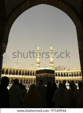 Silhouette of Muslim pilgrims get ready to circumambulate the Kaabah. - stock photo