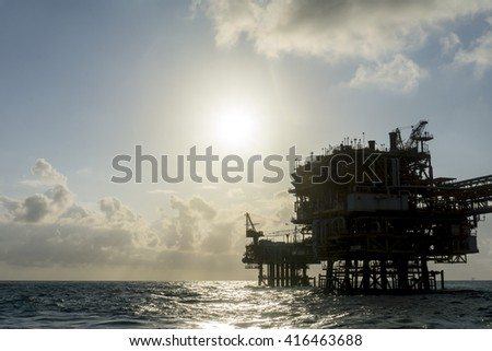 Silhouette of oil and gas platform in the middle of South China Sea.