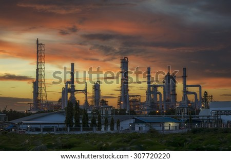 Silhouette of Oil and gas refinery at twilight