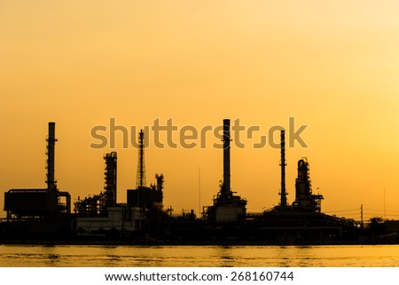 silhouette of oil and gas refinery petrochemical factory - stock photo
