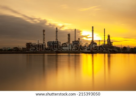 Silhouette of Oil refinery with sunset background