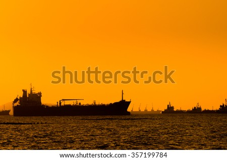 Silhouette of Oil tanker and Gas tanker - stock photo