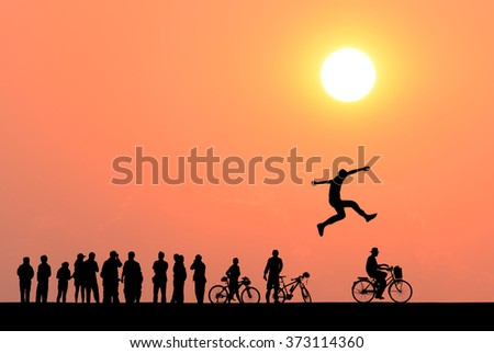 Silhouette of one man jumping over many people on sunset background , business concept